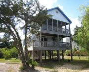 This Tastefully Decorated Ocracoke Island Vacation Home Offers Reverse Floor Plan, And Is Nestled In The Treetops. - Ocracoke Island Realty--Vacation Rentals