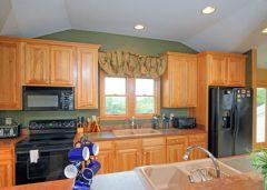Kitchen in Captain's Landing's penthouse suite
