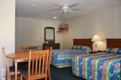 Efficiency room with two double beds at Pony Island Motel