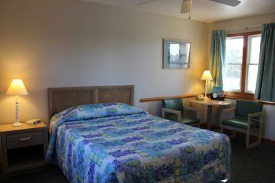 Room with one queen bed at Pony Island Motel