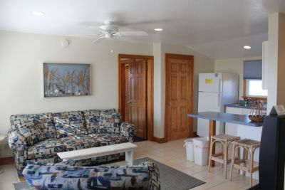 Sitting area of poolside room at Pony Island Motel