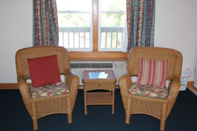 Seating area of poolside room at Pony Island Motel