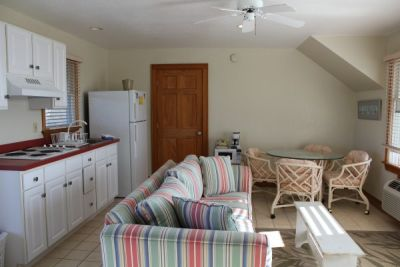 Kitchen and eating area of poolside room at Pony Island Motel